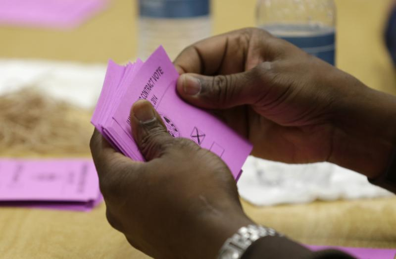 A volunteer vote counter tallies ballots Friday, Jan. 3, 2014, at the Boeing machinists union hall in Seattle.