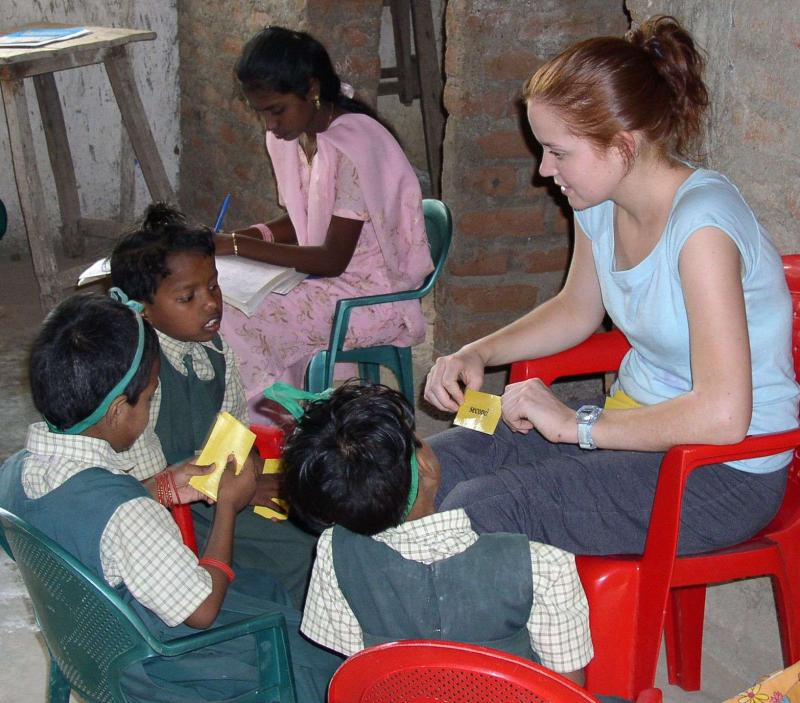 Maria Haley, right, from Brantford, Ontario volunteers with children while on her vacation in India.