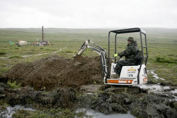 FILE- In this July 13, 2007 file photo, a worker with the Pebble Mine project test drills in the Bristol Bay region of Alaska near the village of Iliamma, Alaska.