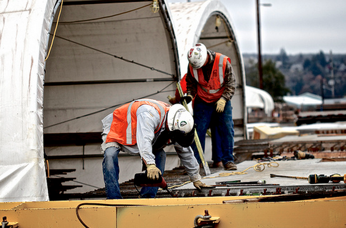 On Oct. 16, 2013 at the pontoon casting facility in Aberdeen, crews could be seen outside of the basin preparing interior precast panels prior to setting them into cycle 4 pontoons.