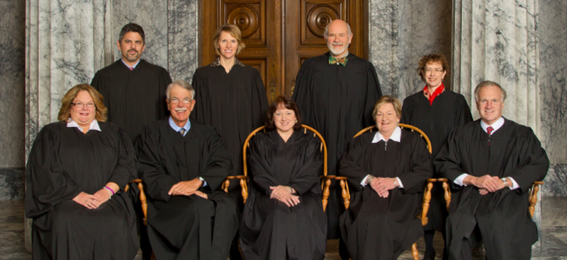 This photo shows the nine justices of the Washington State Supreme Court.