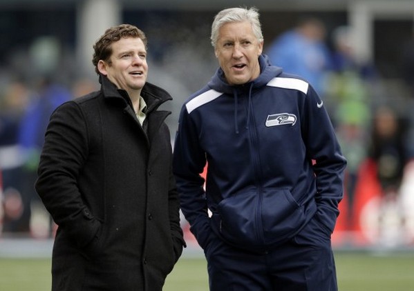 Seahawks general manager John Schneider, left, and coach Pete Carroll talk before an NFL game against the St.Louis Rams in Seattle on Dec. 29, 2013.