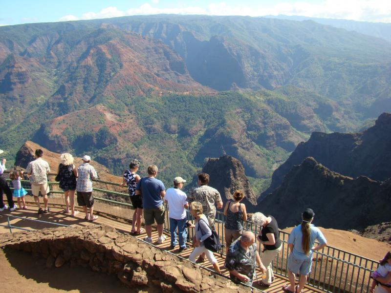 This Jan. 5, 2012 photo shows tourists lining up to view Waimea Canyon on the island of Kauai, Hawaii. The natural wonder has been dubbed the Grand Canyon of the Pacific.