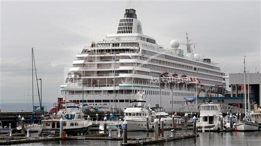 The Crystal Symphony sits moored in Seattle in 2011. Cruises are a good way to travel if you want a firm itinerary, Brumley says.