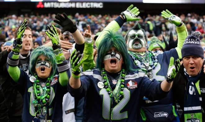 Seahawks fans cheer late in the second half against the St. Louis Rams, Sunday, Dec. 29, 2013, in Seattle.