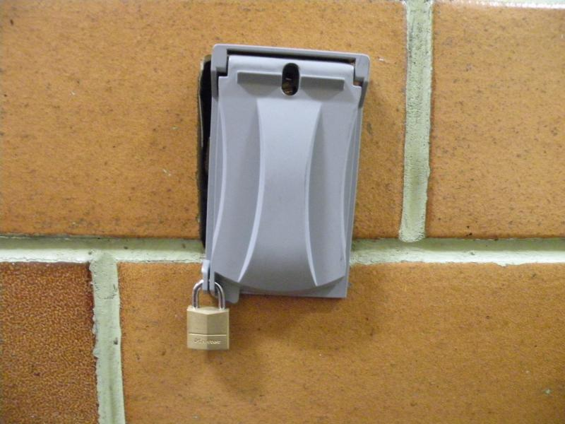 Outlets in the Armory, formerly the Seattle Center House, are blocked with covers and padlocks.