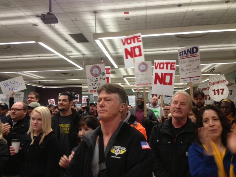 Machinists are seen rallying against Boeing's contract extension offer.