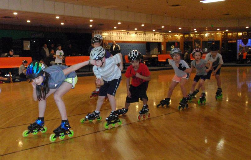Youth inline skaters line up to practice sprint starts at Pattison's West in Federal Way, Wash.