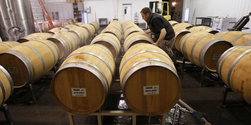 FILE - In this photo taken Monday, April 27, 2009, assistant wine maker Bill Mansker adjust a barrel of a white blend wine at the L'Ecole No. 41 winery in Lowden, Wash., near Walla Walla, Wash.