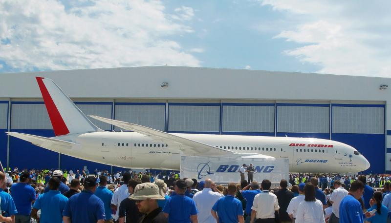 FILE - In an Friday, April 27, 2012 photo, Boeing workers work gather around the first 787 manufactured at the company's assembly plant in North Charleston, S.C.