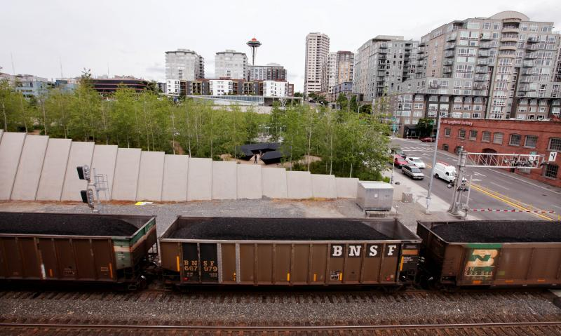 A train hauling coal to British Columbia heads north out of downtown Seattle and in view of the Space Needle Tuesday afternoon, May 29, 2012.