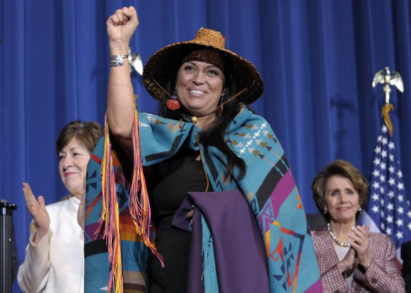 FILE - Deborah Parker, vice chairwoman of the Tulalip Tribes of Washington State, center, gestures before President Barack Obama before he signed the Violence Against Women Act, Thursday, March 7, 2013.