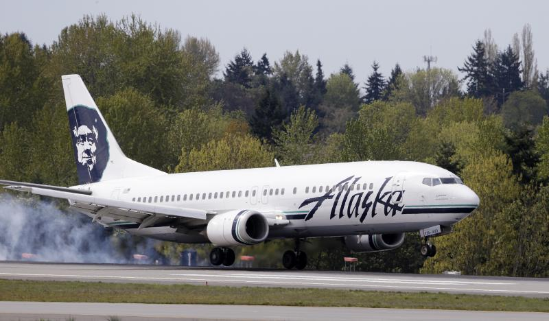 An Alaska Airline jet lands at Seattle-Tacoma International Airport Tuesday, April 23, 2013, in Seattle.