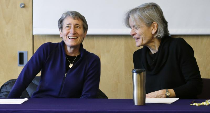 U.S. Interior Secretary Sally Jewell, left, talks with Lisa Graumlich, dean of the College of the Environment, before beginning a roundtable discussion at the University of Washington, Tuesday, Feb. 4, 2014, in Seattle.