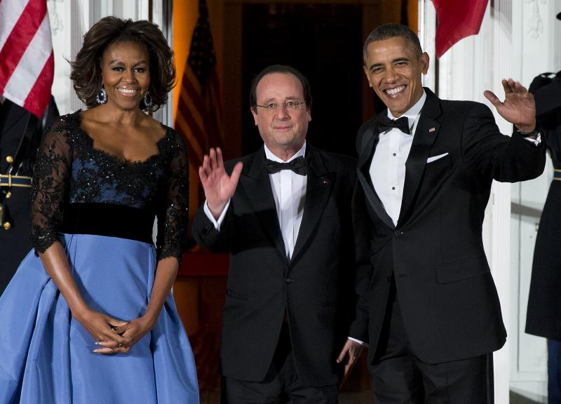 First lady Michelle Obama, left, and President Barack Obama welcome French President François Hollande for a State Dinner at the North Portico of the White House on Tuesday, Feb. 11, 2014, in Washington.