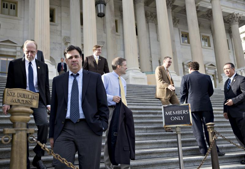 FILE - Rep. Raul Labrador, R-Idaho, second from left, and other members of the House of Representatives leave after the Republican-controlled House voted to let insurance companies sell individual health coverage to all comers.