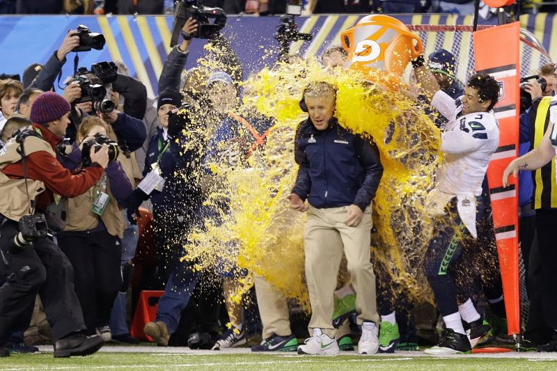 Seattle Seahawks head coach Pete Carroll is doused with Gatorade late in the second half of the NFL Super Bowl XLVIII football game Sunday, Feb. 2, 2014, in East Rutherford, N.J.