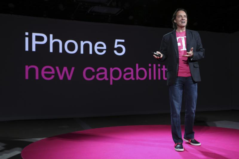 FILE - T-Mobile CEO John Legere speaks during a news conference Tuesday, March 26, 2013 in New York.