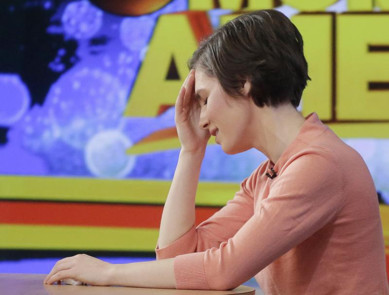 Amanda Knox puts her hand to her forehead while making a television appearance, Friday, Jan. 31, 2014 in New York.