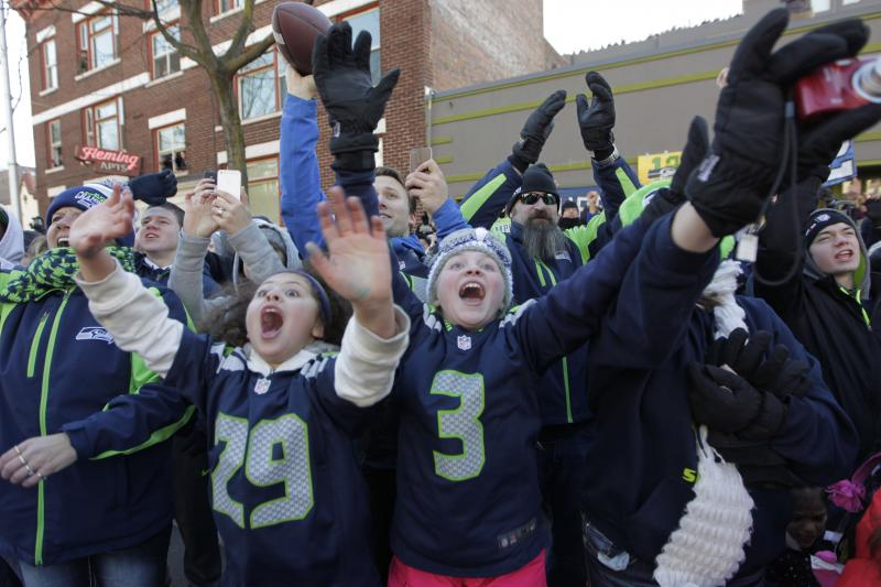 Young fans wave as Seahawks players pass by during the Seahawks Super Bowl victory parade.