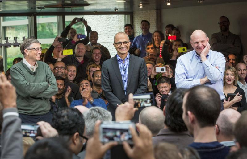 Satya Nadella, Microsoft's new CEO, addresses employees along with Bill Gates and Steve Ballmer on the company's Redmond, Wash., campus.