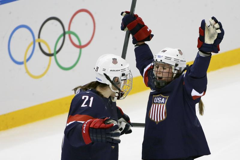 Kelli Stack of the Untied States celebrates her goal with teammate Hilary Knight during the second period of the 2014 Winter Olympics women's ice hockey game against Finland at Shayba Arena, Saturday, Feb. 8, 2014, in Sochi, Russia.