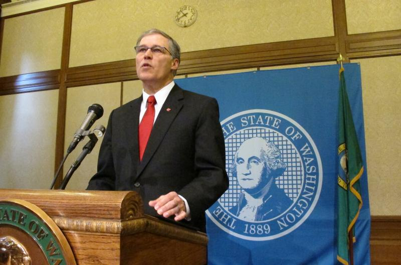 Gov. Jay Inslee announces Tuesday, Feb. 11, 2014, that he is suspending the use of the death penalty in Washington state during a news conference in Olympia, Wash.