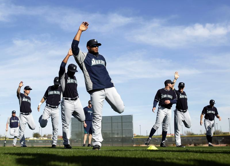 Seattle Mariners second baseman Robinson Cano, front, stretches with his teammates before baseball spring training, Tuesday, Feb. 18, 2014, in Peoria, Ariz.