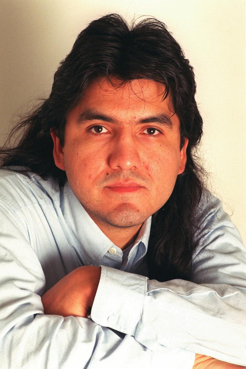 FILE - Author and poet Sherman Alexie poses in New York June 23, 1998.