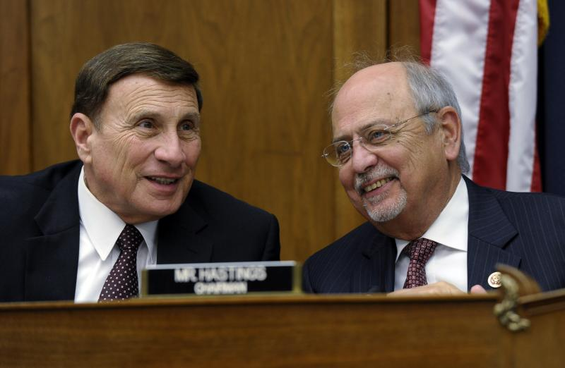 House Natural Resources Committee Chairman Rep. Doc Hastings, R-Wash., right, talks with Rep. John Mica, R-Fla., left, during a hearing.l
