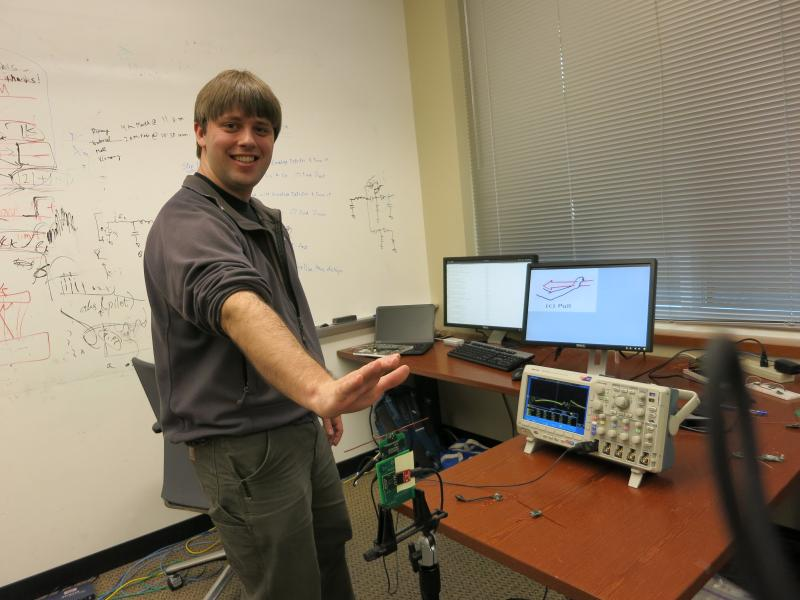UW engineering grad student Bryce Kellogg demonstrates the All-See technology.