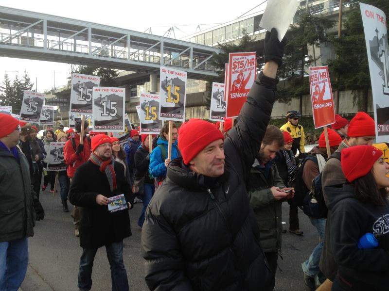 Low-wage workers march from SeaTac to Seattle to advocate for a $15 per hour minimum wage.