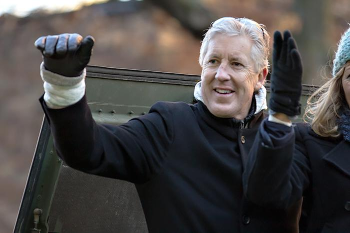 Seahawks coach Pete Carroll waves to the crowd.