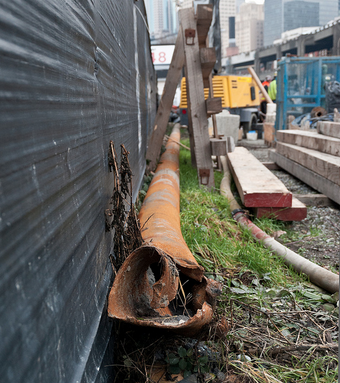 A 57-foot-long section of steel pipe lies in the SR 99 tunnel construction yard.