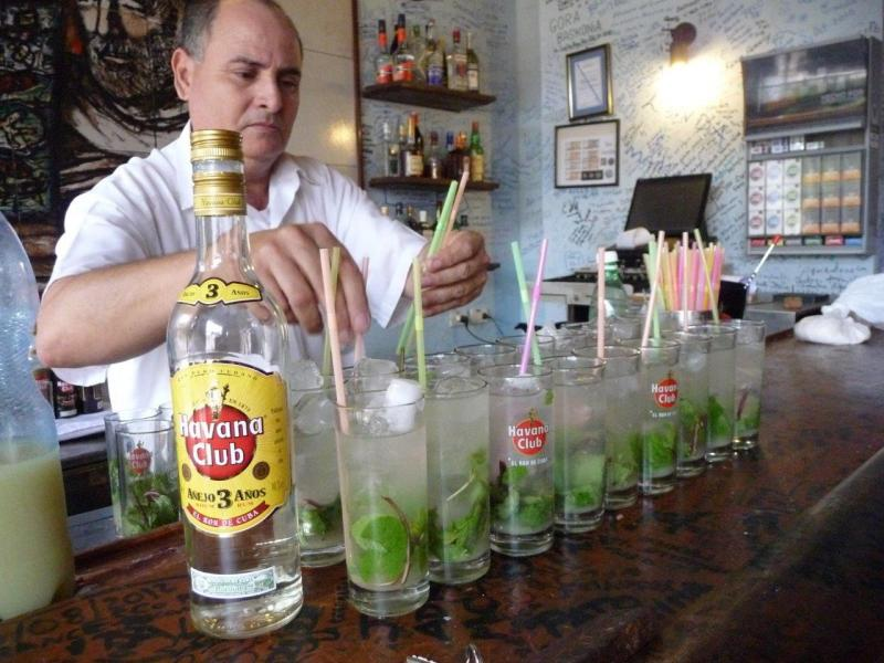 A bartender mixes mojitos in Havana.