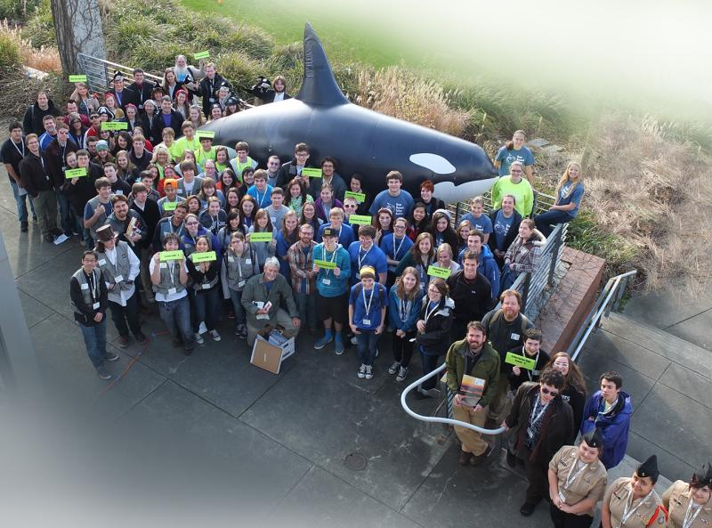 "In this 2013 photo, Seattle Orca Bowl participants pose with our full-sized replica of J-26, also known as ""Mike""."
