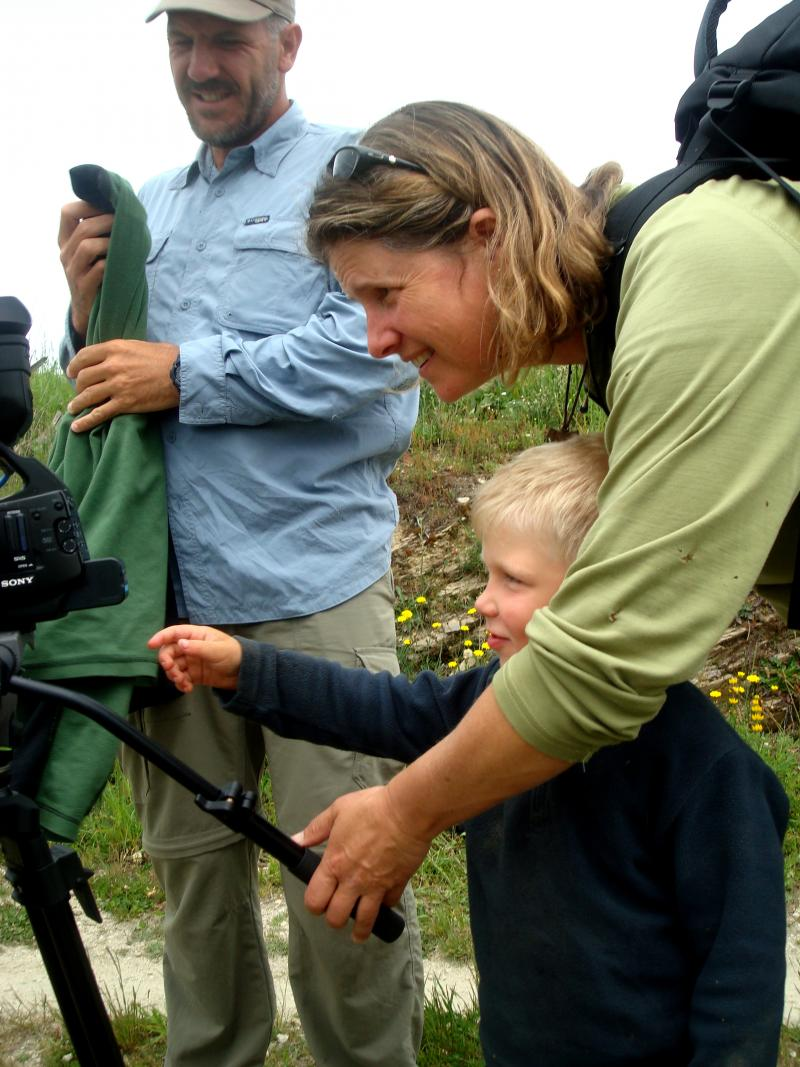 Director Lydia B. Smith behind the camera with one of the pilgrims profiled in her movie, a 3-year-old boy named Syrian.