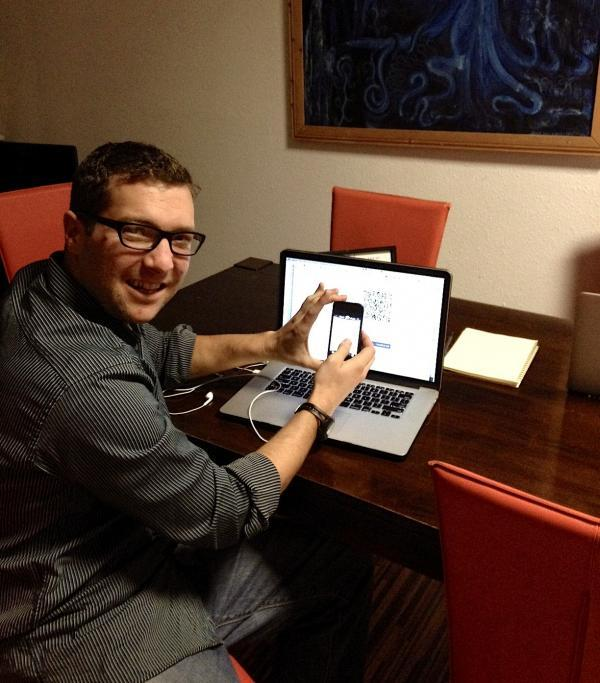 Nicholas Cary is seen making his bitcoin contribution to the University of Puget Sound from his hotel room in Berlin.