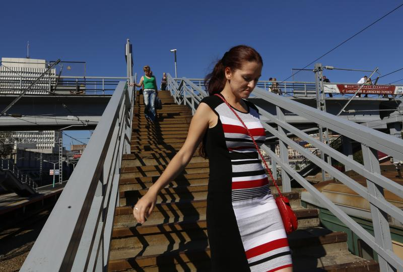 A woman walks down the stairs at the train station in the eastern Russian city of Vladivostok in late 2012. The main line of the Trans-Siberian Railroad runs between Vladivostok and Moscow, nearly 4,000 miles to the west.