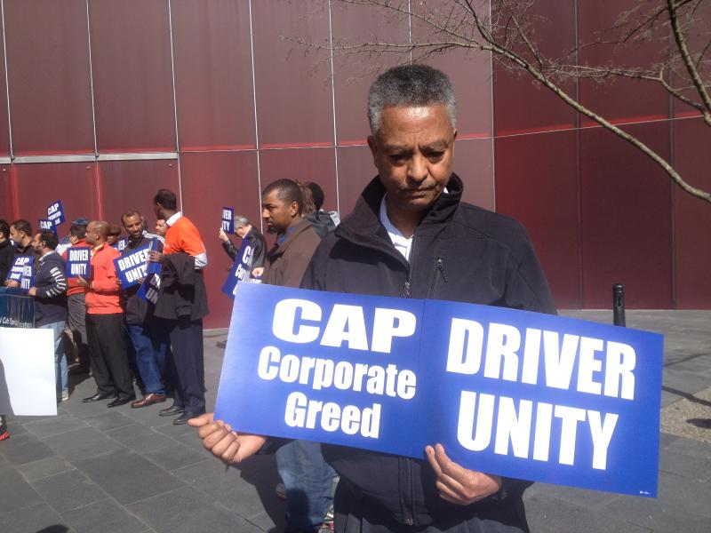 Wessen Darge, a taxi driver of more than 20 years, says his income is down about 35 percent in the past year as a result of exploding competition from rideshare companies.
