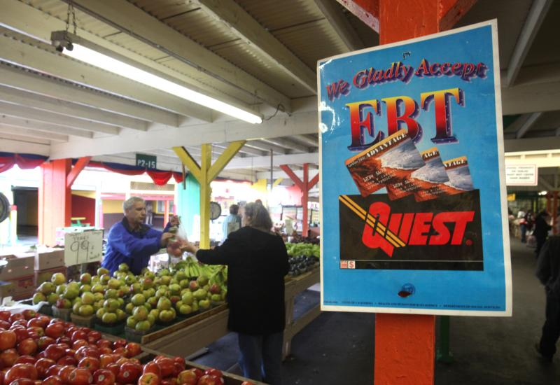 In this photo taken Saturday, Feb. 6, 2010, a sign announcing the acceptance of electronic Benefit Transfer cards is seen at a farmers market in Roseville, Calif.