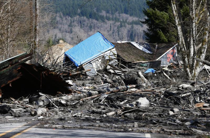 A house is seen destroyed in the mud on Highway 530 next to mile marker 37 on Sunday, March 23, 2014, the day after a giant landslide occurred near mile marker 37 near Oso, Washington.