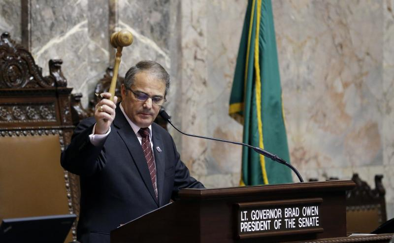 Lt. Gov. Brad Owen bangs the gavel as he conducts business in the Senate chamber on the first day of the 2014 session of the Washington state Legislature, Monday, Jan. 13, 2014, at the Capitol in Olympia, Wash.