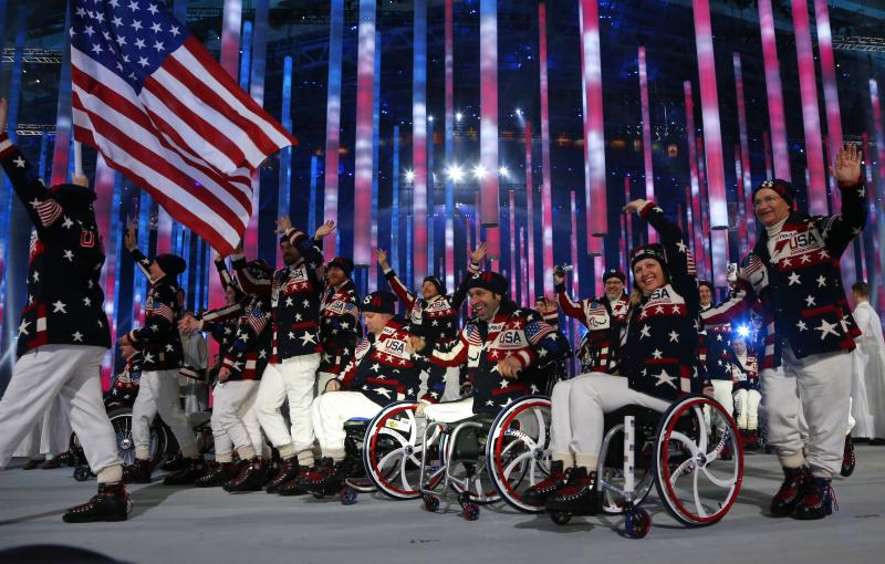 Athletes and officials of United States enter the arena during attend the opening ceremony of the 2014 Winter Paralympics at the Fisht Olympic stadium in Sochi, Russia, Friday, March 7, 2014.