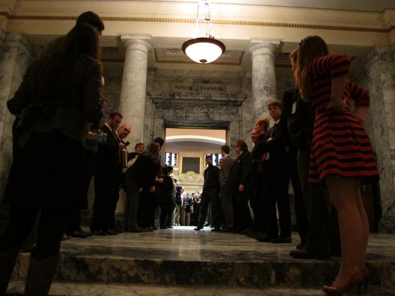 Legislative staff and others line up outside of the House chamber in advance of the Legislature adjourning its 60-day session, on Thursday, March 13, 2014, in Olympia, Wash.