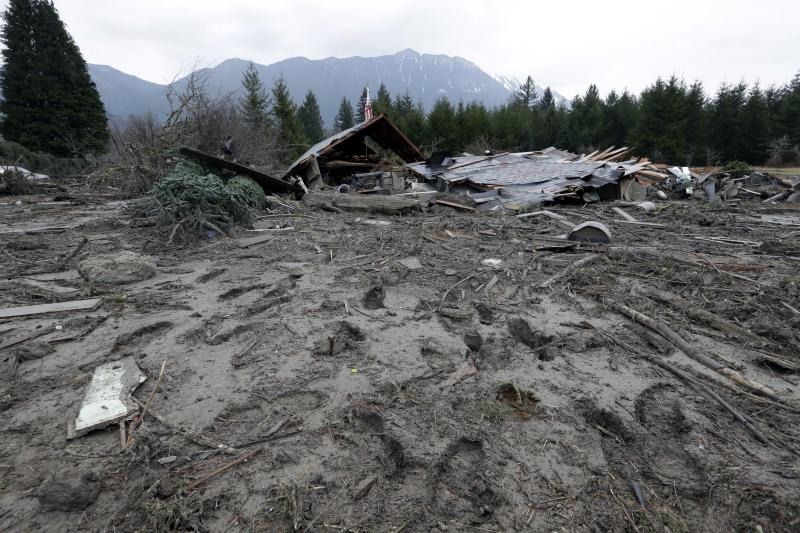 Footprints from searchers remain in mud at the edge of a deadly mudslide Tuesday, March 25, 2014, in Oso, Wash.