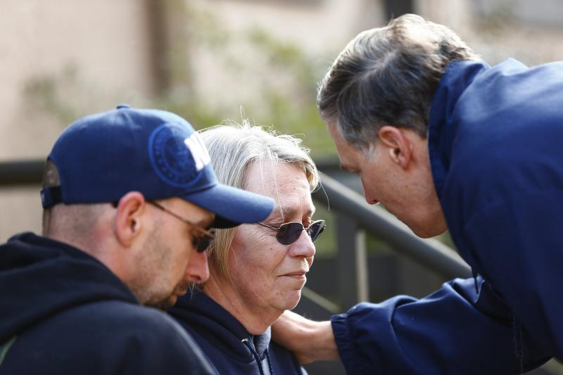 Washington Governor Jay Inslee talks privately with two residents personally affected by the mudslide after a media presser at Arlington City Hall on Sunday, March 23, 2014.
