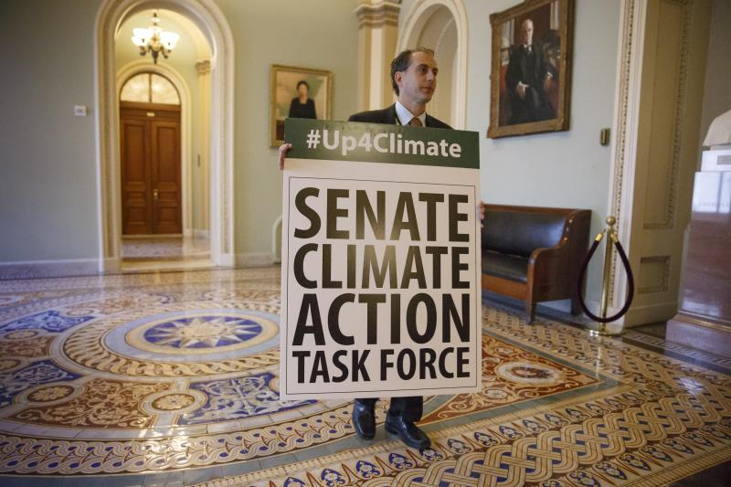 Joe Mendelson, the majority chief climate counsel with the Senate Committee on Environment, waits outside the Senate chamber on Capitol Hill in Washington, Tuesday, March 11, 2014.