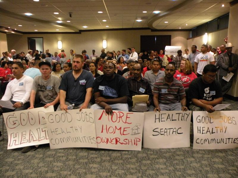 Workers showed up at a SeaTac City Council meeting last year to push for the $15/hour minimum wage