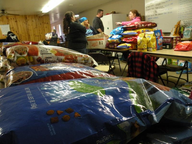 """More than 100 bags of cat and dog food pile up inside the """"clubhouse"""" on the Darrington Rodeo Grounds."""